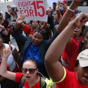 "The ""Fight for 15"" movement is made up of people like Clara Davis, who, in the text of the piece by Jill Charles, has to work 2 jobs and still is eligible for WIC."